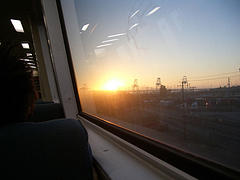 Sunrise From Inside Train